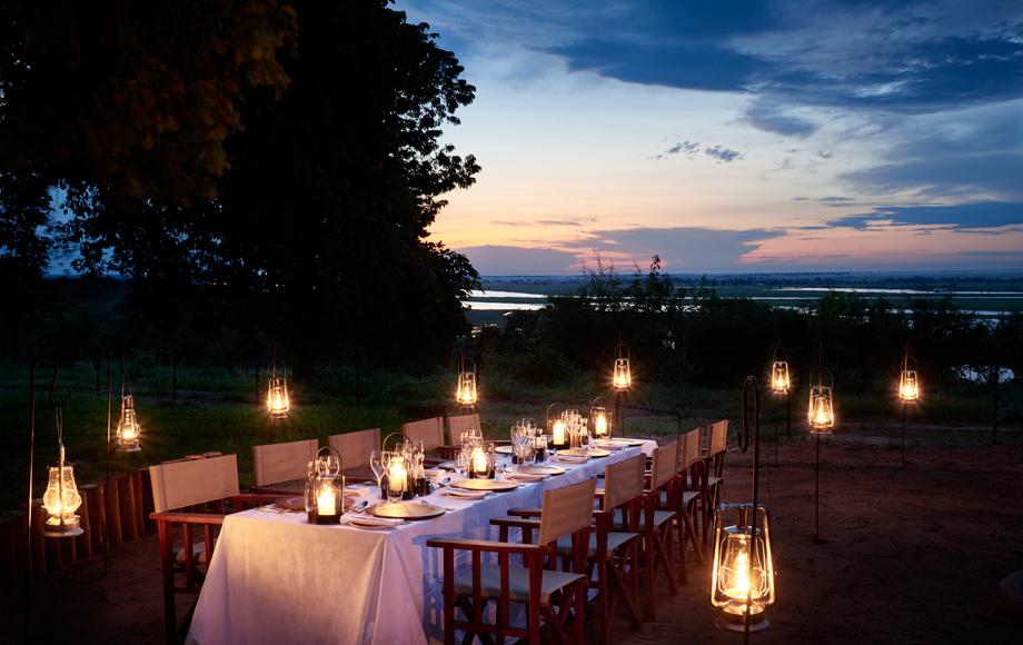 Outdoor dinner at Chobe Chilwero