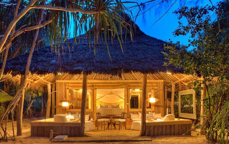Mnemba Island Lodge at night in Zanzibar