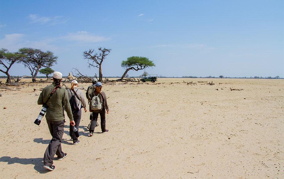James walking in Hwange National Park in Zambia