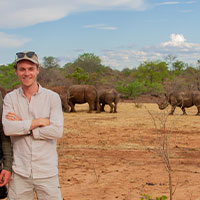 Jeremy in Zambia with White Rhino