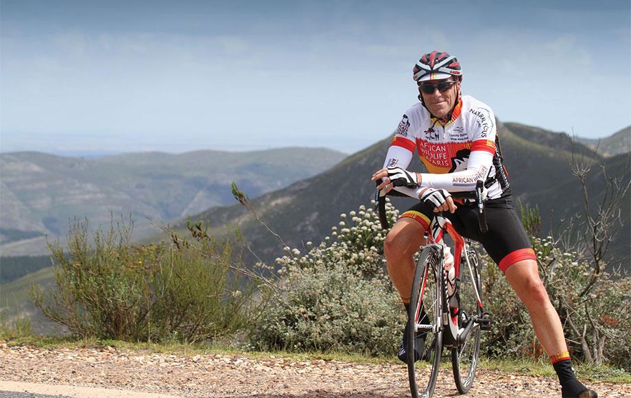 Steve riding bike through Cape Argus