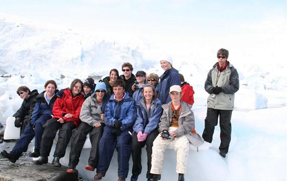 Jeremy in Antarctica sitting on Iceberg