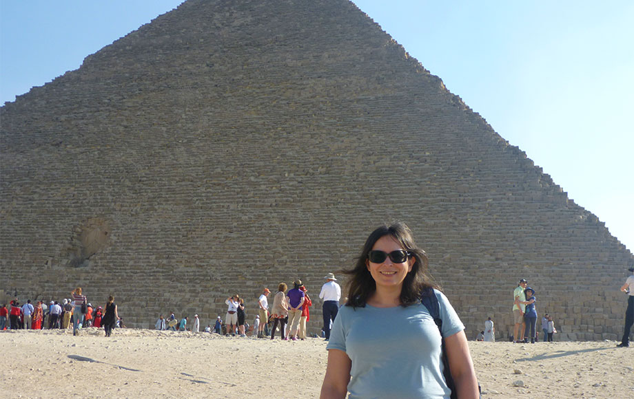 Natasha standing in front of the Pyramids in Egypt