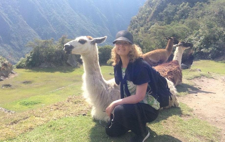 Anna at Machu Picchu with an Alpaca