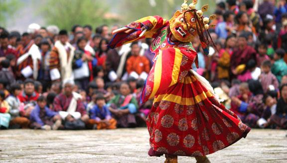 Bhutan festival tours masked dancers