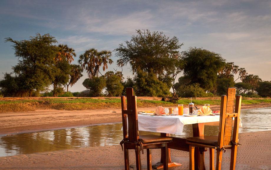 Dining on river bank at Elephant Bedroom Camp in Kenya