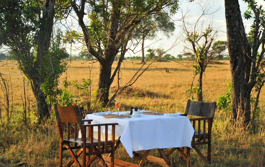Dining outside at luxury Lemala Mara in Tanzania