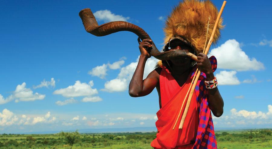 Masai Warrior blowing horn in Kenya