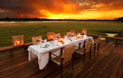 Dining at sunset at Zungulila Bushcamp on the Kapamba River